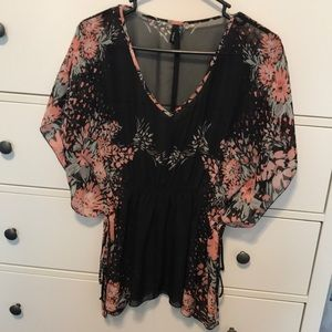 Sheer black top with floral detail